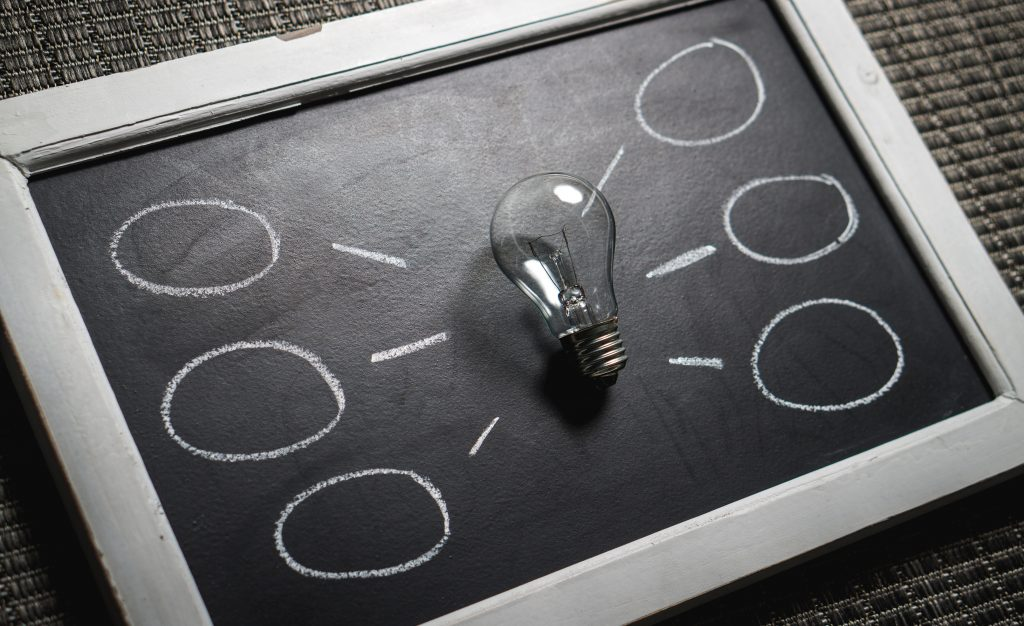 lightbulb on blackboard